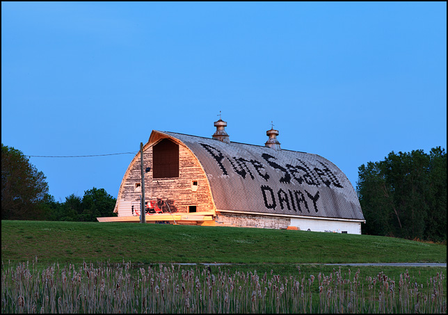 The abandoned Pure Sealed Dairy barn at sunset. The name of the dairy is spelled out in the shingles on the roof of the barn, located on Bass Road in Fort Wayne, Indiana.