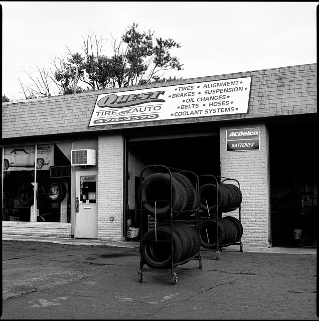 A rack of tires in front of the open garage doors at Quest Tire and Auto on Lower Huntington Road in the Waynedale area of Fort Wayne, Indiana.