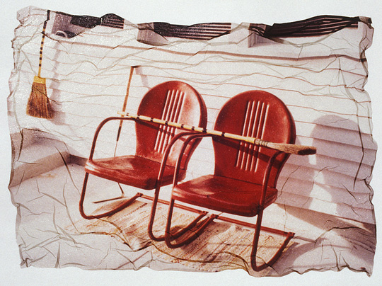 Polaroid emulsion transfer photograph of two red motel chairs behind an old white farmhouse in rural Indiana.