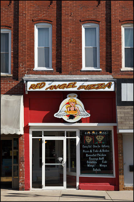 Red Angel Pizza is a small locally-owned storefront pizzeria in a 19th Century brick commercial building on High Street in the small town of Hicksville, Ohio.