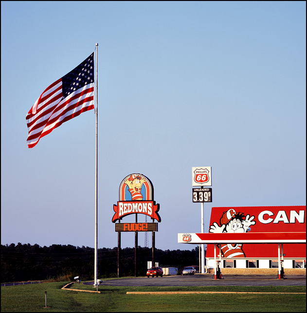 A giant American flag flies over Redmons Candy Factory and Phillips 66 gas station on Interstate 44 in Missouri.