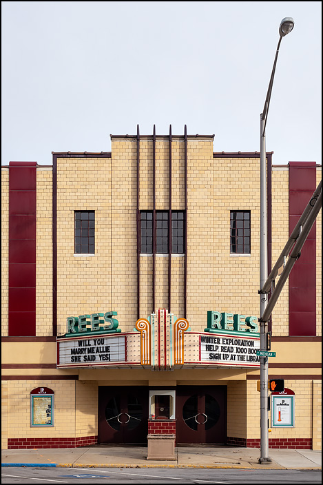The Rees Theatre on Michigan Street in the small town of Plymouth, Indiana. The historic building has an Art Deco glazed terra-cotta facade. The sign says, Will You Marry Me Allie? She Said Yes!