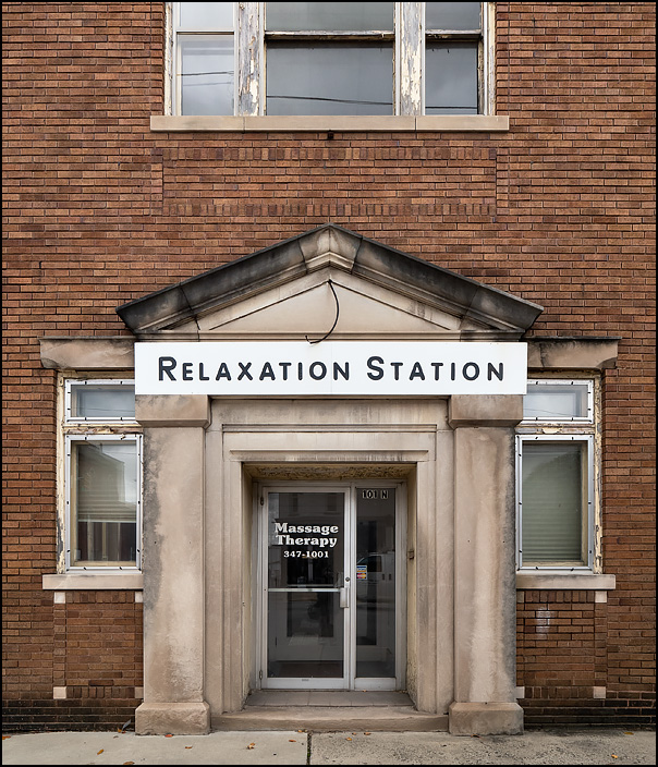 Relaxation Station is a former massage therapy place on Main Street in the small town of Kendallville, Indiana. The brick building was originally a bank, and still has a heavy neoclassic limestone entryway.