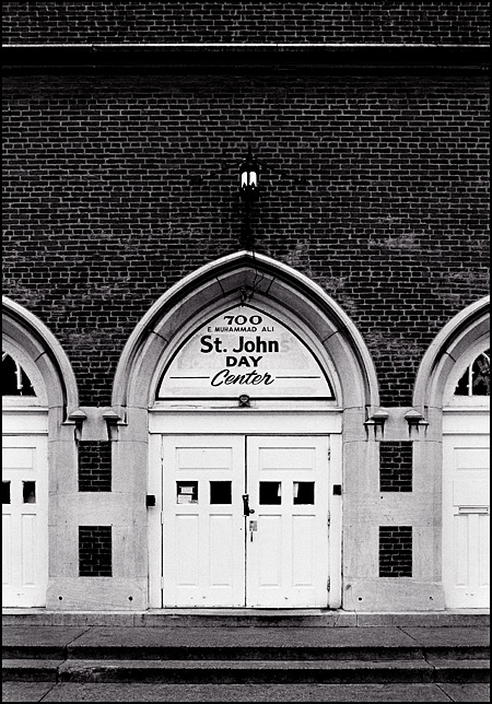 The front doors of Saint John Day Center, a homeless shelter in a former brick gothic style church in Louisville.