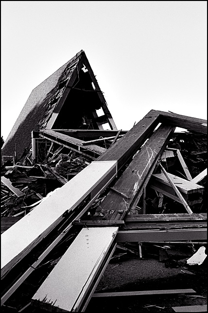 A wooden A-Frame on the ground in front of the partially demolished sanctuary of Saint Michael's Lutheran Church on Getz Road in Fort Wayne, Indiana.