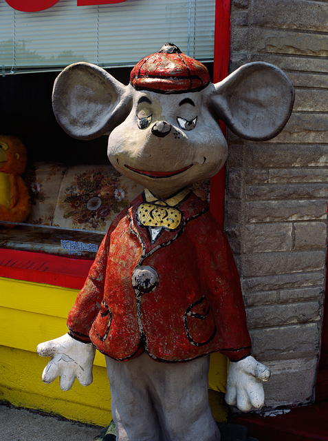Giant mouse statue in front of the S'All Good furniture store on Wells Street in Fort Wayne, Indiana.