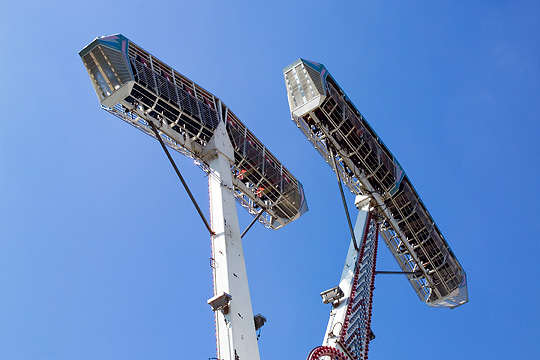 The riders are upside down in the Screamer carnival ride.