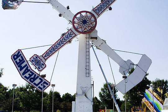 The Screamer ride in the middle of its rotation at the Three Rivers Festival carnival in Fort Wayne, Indiana.