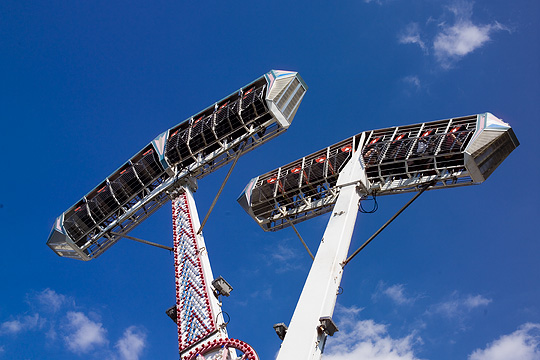 The people on the Screamer ride are suspended upside down.