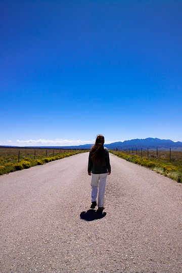 Self Portrait of fine art photographer Christopher Crawford walking along Waldo Canyon Road toward the Ortiz Mountains in New Mexico.