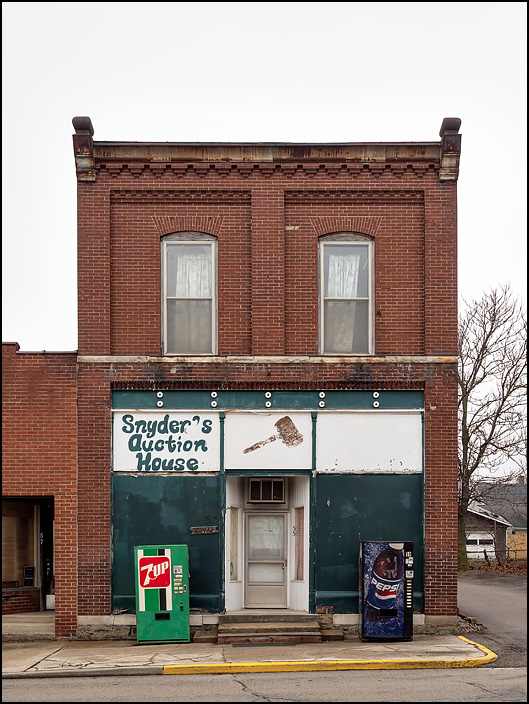 Snyders Auction House is located in a storefront in an old brick building on Main Street in the small town of Andrews, Indiana.