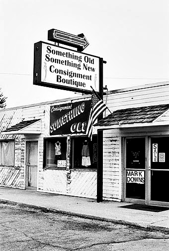 An American Flag hangs over the entrance to Something Old Something New Consignment Boutique on Lower Huntington Road in the Waynedale area of Fort Wayne, Indiana.