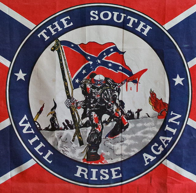 A skeleton carrying a Confederate flag, with the motto, The South Will Rise Again.