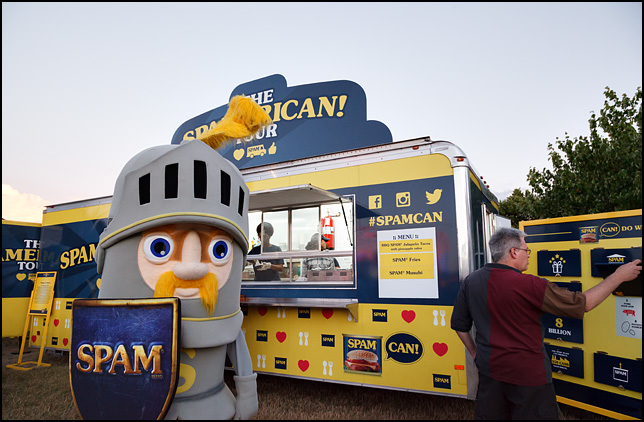 A man in a medieval knight costume advertising SPAM meat in front of the Spamerican Tour trailer Three Rivers Festival in Fort Wayne, Indiana. Sir Can-A-Lot the SPAM Knight.