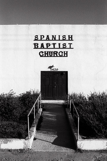 Spanish Baptist Church in Santa Fe, New Mexico. The building is an austere adobe pueblo style building.