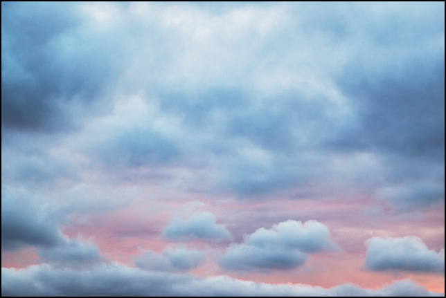 Abstract photograph of clouds against a colorful sky in rural Elkhart County, Indiana.