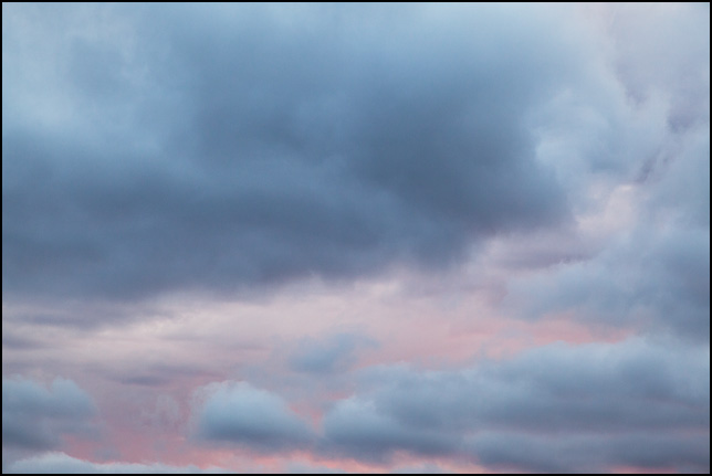 Abstract photograph of clouds against a pink sunset sky in rural Elkhart County, Indiana.