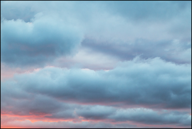 Abstract photograph of blue clouds against a red sunset sky in rural Elkhart County, Indiana.