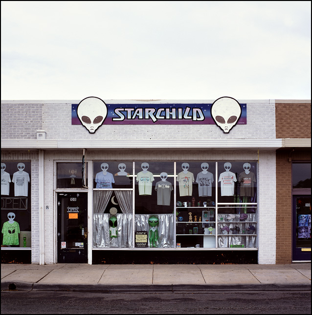 Toy aliens fill the front windows of the Starchild UFO souvenir shop in Roswell, New Mexico.