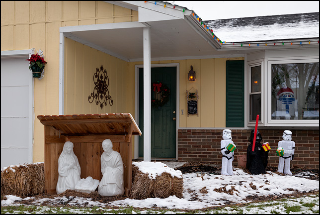 A Christmas nativity scene with Darth Vader and two Imperial Stormtroopers portraying the three wise men. R2D2 is in the window, wearing a Santa hat. The house is on Albert Drive in Fort Wayne, Indiana.