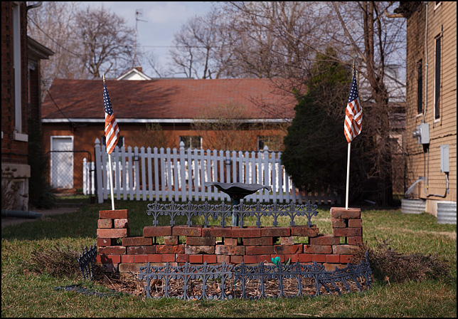 Two American flags in a patriotic display in a yard in a working class neighborhood in Fort Wayne, Indiana.