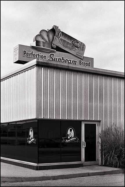 A Sunbeam Bread sign on top of the Aunt Millie's Bakery outlet on Hillegas Road in Fort Wayne, Indiana. It is a small replica of the famous Sunbeam sign on the downtown Perfection Bakery factory.