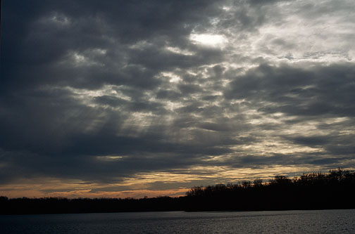 The sun sets over Goose Lake in Whitley County, Indiana.