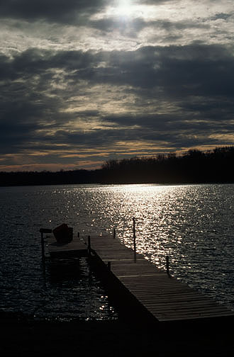 My grandfather's pier at Goose Lake in Whitley County, Indiana photographed at sunset.