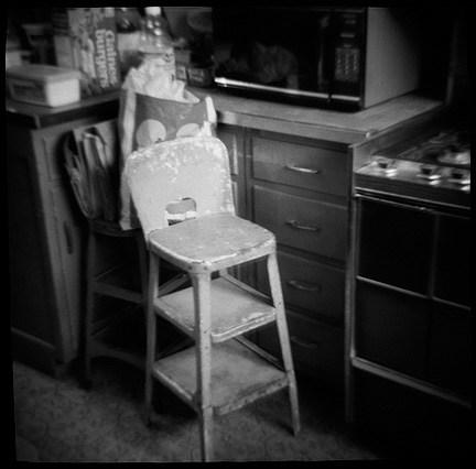 A dreamy toy camera photograph of two tall metal stools sitting in my grandfather's kitchen.