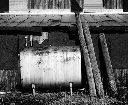A rusty old heating oil tank next to a weathered barn in southeast Allen County, Indiana.