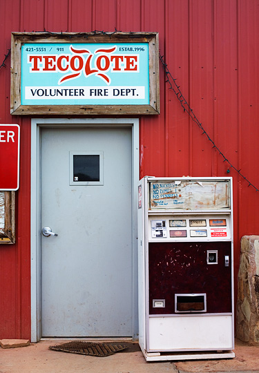 An old Doctor Pepper soda pop vending machine in front of the Volunteer Fire Department in the small town of Tecolote, New Mexico.