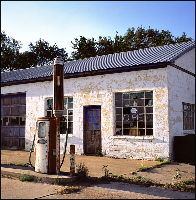 An abandoned gas station with old Tokheim gas pumps on Route 66 in McLean, Texas.