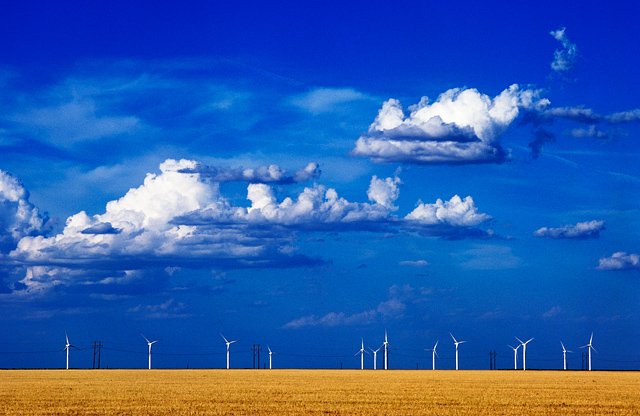 A group of windmills that generate electricity stand in a wheat field in Oldham County, Texas just east of the town of Vega.