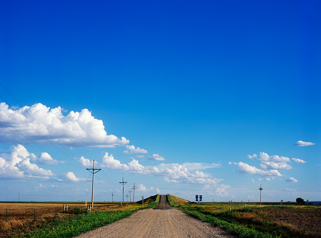 Looking south on Everett Road toward the bridge that crosses Interstate 40 in Oldham County, Texas near Vega. Landscape in the Texas panhandle with big blue sky.