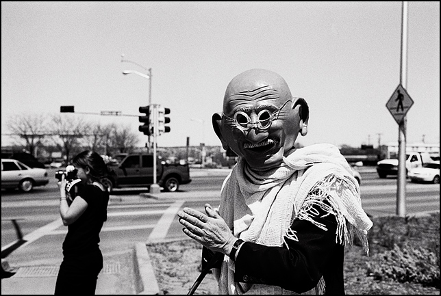 A peace activist wearing a paper mâché Gandhi mask during the weekly antiwar protest in Santa Fe.