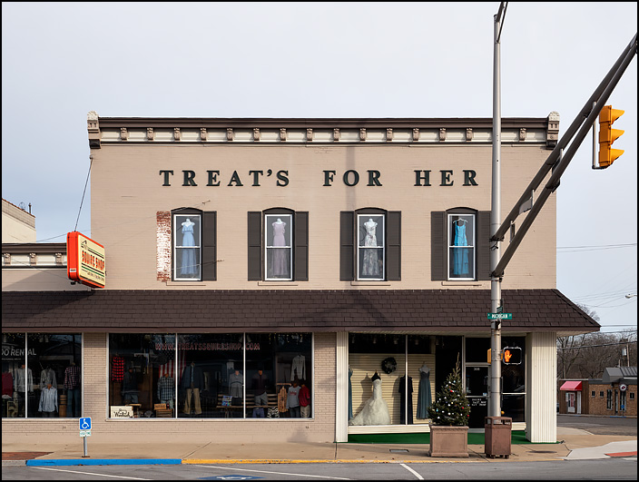 Treats Bridal Shoppe on Michigan Street in the small town of Plymouth, Indiana. The sign on the building says Treats For Her.