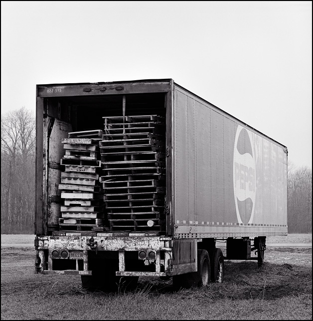 An Abandoned Pepsi Truck Filled With Old Wooden Pallets