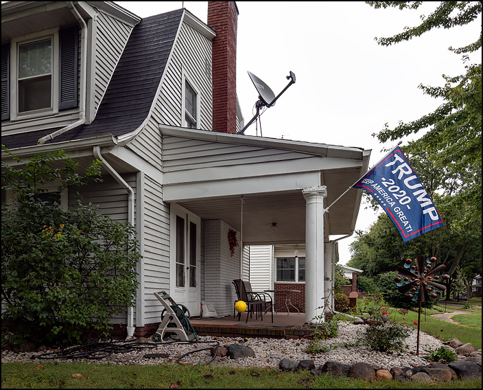 A house with a political flag on Bayer Avenue in Fort Wayne, Indiana. Trump 2020, Keep American Great.