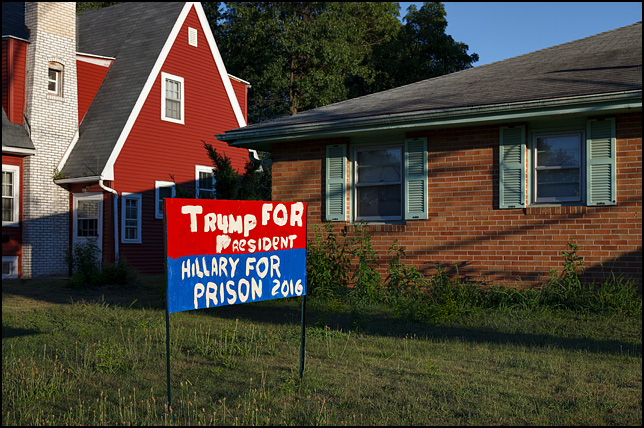A crudely made hand-painted political sign in the front yard of a house on Lincoln Highway in Mishawaka, Indiana. Trump For President and Hillary For Prison 2016.
