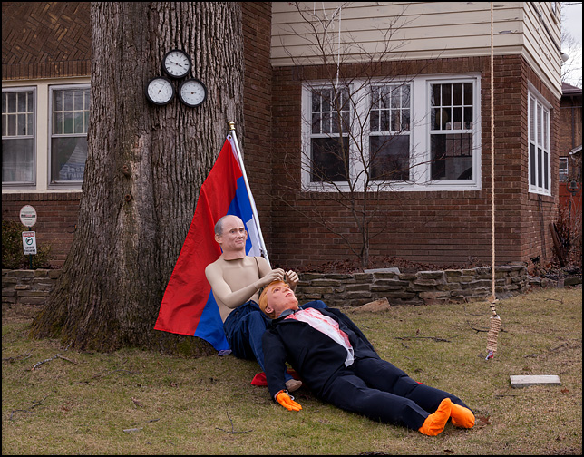 A lifesize Vladimir Putin doll holding Donald Trump after he was hanged in effigy from a tree in front of a house on Oakdale Drive in Fort Wayne, Indiana. A Russian Flag is draped behind Putin.