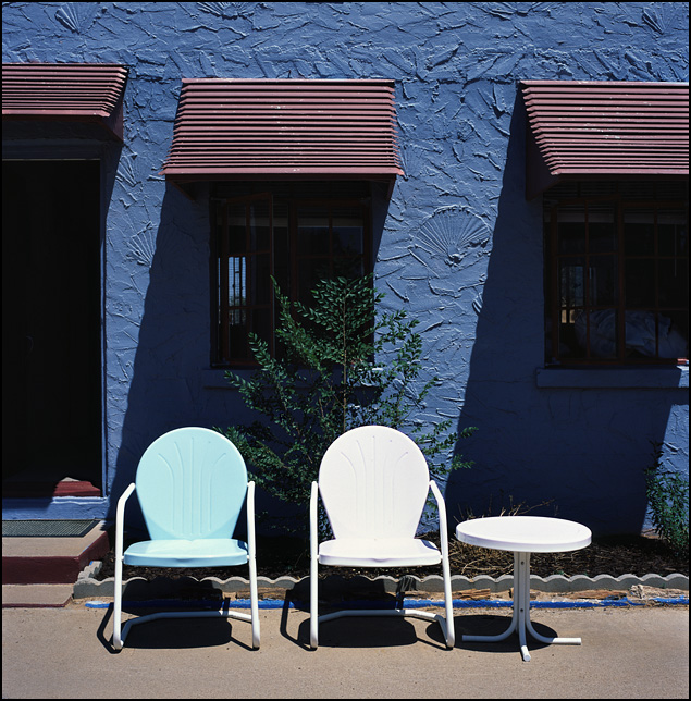 A pair of metal lawn chairs outside a room at the Blue Swallow Motel on Route 66 in Tucamcari, New Mexico.