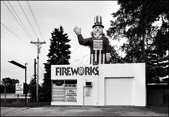 A fireworks store in an old gas station with an inflatable Uncle Sam on top of the building on US-30 in LaPorte County, Indiana.