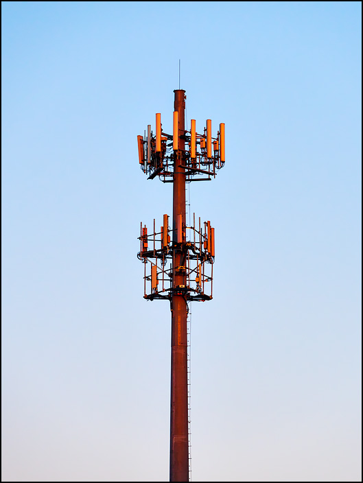 A cellphone tower at sunset. The tower is a steel pole on US-33 on the northwest side of Fort Wayne, Indiana.