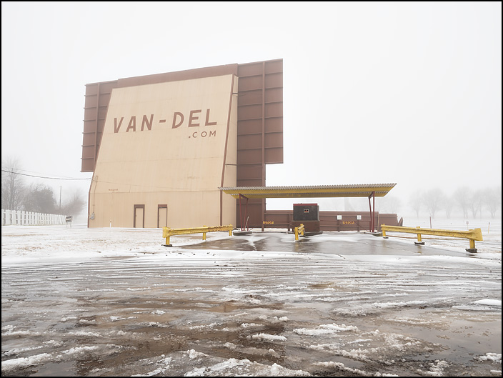 The outside of the Van-Del Drive-In Theatre on a foggy winter day. It is on Lincoln Highway outside the small town of Middle Point, Ohio.
