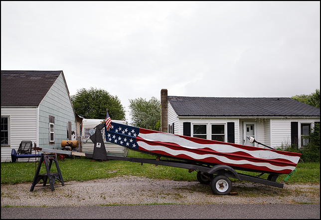 An aluminum rowboat painted in the colors of the American flag in the small town of Van Buren, Indiana.