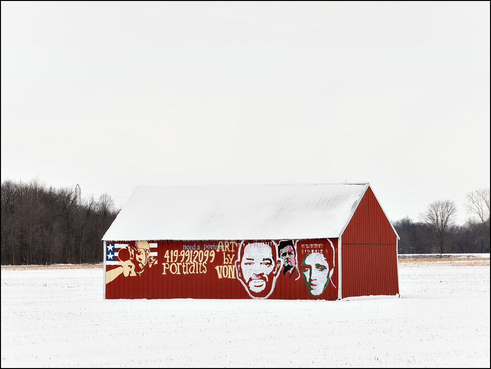A red barn with a mural on the side advertising Art By Von, a portrait painter. Located on Parent Road and I-469 just outside Fort Wayne in rural Allen County, Indiana.