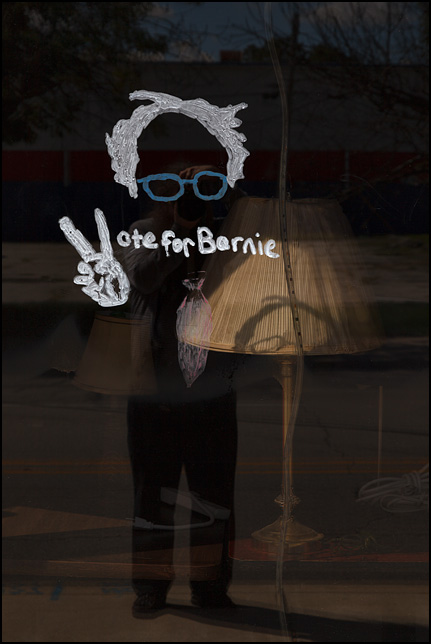 A painting of Bernie Sanders on the front window of his presidential campaign office on Wells Street in Fort Wayne, Indiana. Under the painting, the window says, Vote For Bernie.