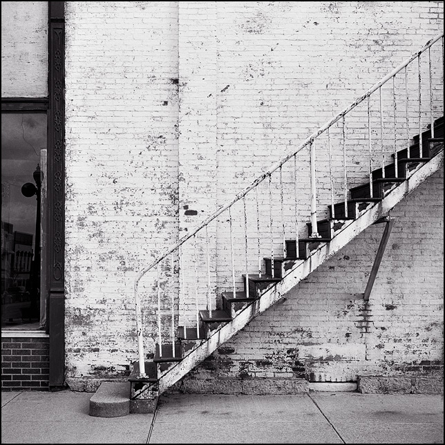 Old metal stairs on the side of a whitewashed brick building on Perry Street in the small town of Wapakoneta, Ohio.