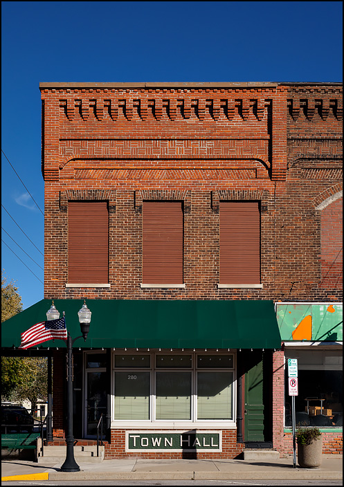 The former Town Hall building on Wayne Street in the small town of Waterloo, Indiana. The brick storefront was originally a bank.