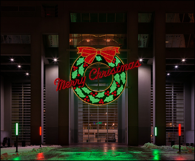 The historic Wolf and Dessauer giant lighted wreath on the back of the Indiana-Michigan Power Center in downtown Fort Wayne, Indiana.